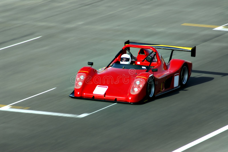 Racing car. A red racing car in action at the track royalty free stock photography
