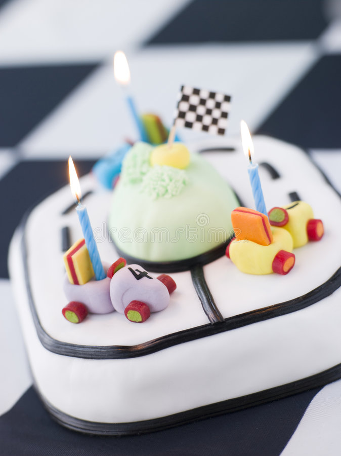 Racing Car Birthday Cake. Close up of Racing Car Birthday Cake on a black and white checkered background stock images