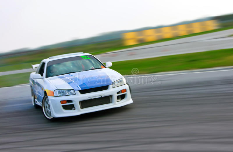 Racing car drift. Ing on the track royalty free stock photography