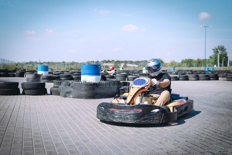 Racing car on the track in action, championship, active sports, extreme fun, the driver keeps his hands on the wheel. protective royalty free stock photos