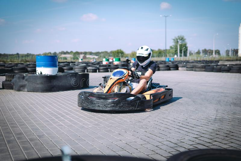 Racing car on the track in action, championship, active sports, extreme fun, the driver keeps his hands on the wheel. protective royalty free stock image