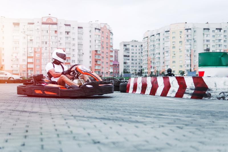 Racing car on the track in action, championship, active sports, extreme fun, the driver keeps his hands on the wheel. protective stock photo