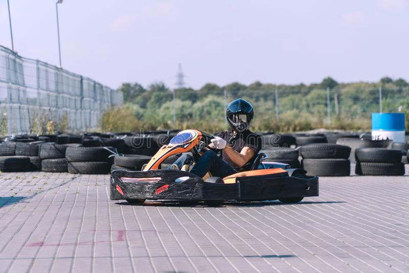 Racing car on the track in action, championship, active sports, extreme fun, the driver keeps his hands on the wheel. protective royalty free stock photography