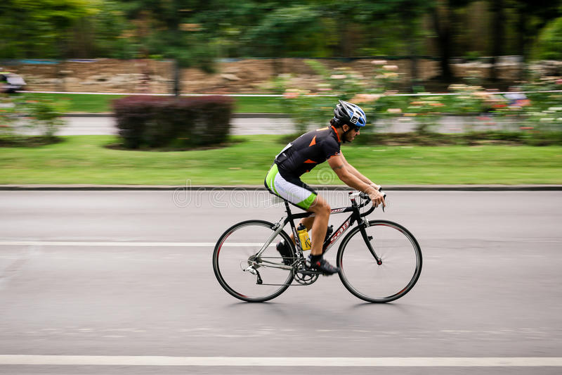 Racing cyclist on road, panning. Cyclist competing in RGT Road Grand Tour Champions Race, Bucharest, Romania royalty free stock photo