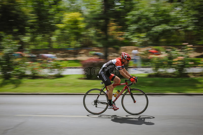 Racing cyclist on road, panning. Cyclist competing in RGT Road Grand Tour Champions Race, Bucharest, Romania stock images