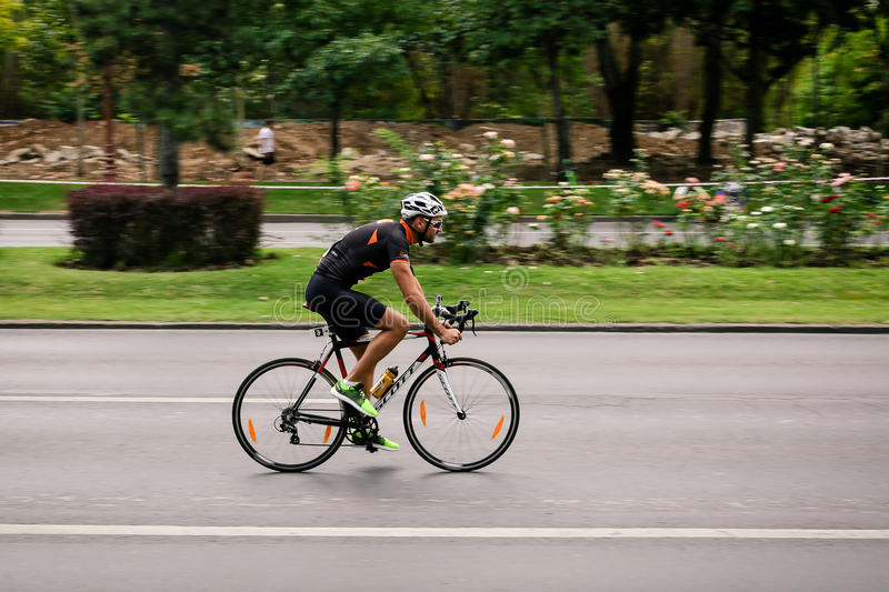 Racing cyclist on road, panning. Happy cyclist competing in RGT Road Grand Tour Champions Race, Bucharest, Romania royalty free stock photo