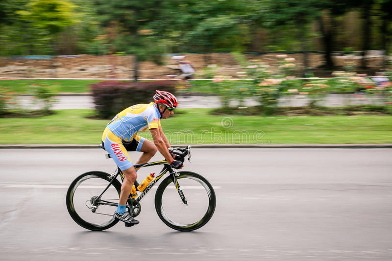 Racing cyclist on road, panning. Middle-age cyclist competing in RGT Road Grand Tour Champions Race, Bucharest, Romania royalty free stock photo