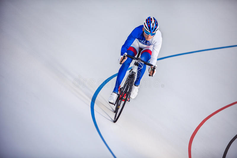 Racing cyclist on velodrome outdoor. stock images