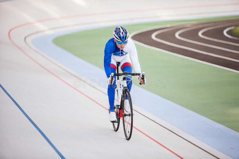 Racing cyclist on velodrome outdoor. stock photography