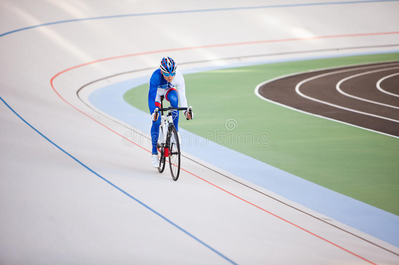 Racing cyclist on velodrome outdoor. royalty free stock photography