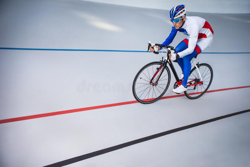 Racing cyclist on velodrome outdoor. royalty free stock photos