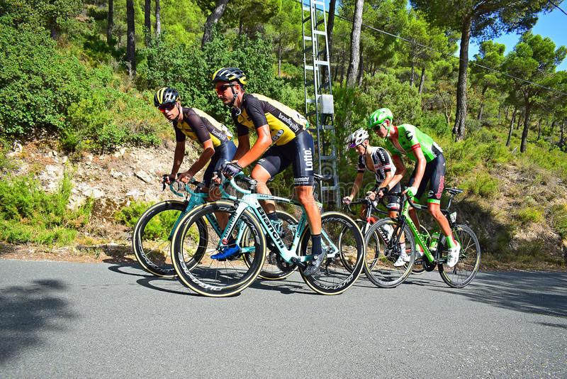 Racing Cyclists On A Hill stock photos