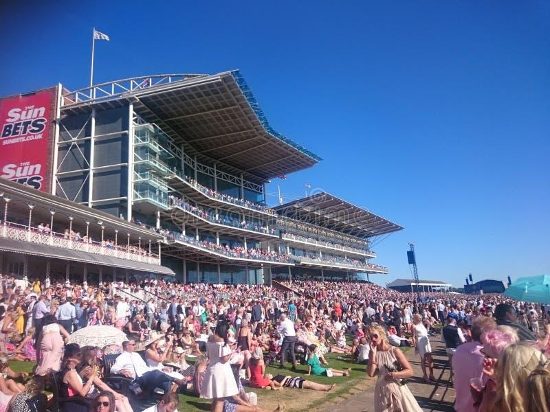 Racing day at York Racecourse Knavesmire York England. Big crowd of men and women royalty free stock image