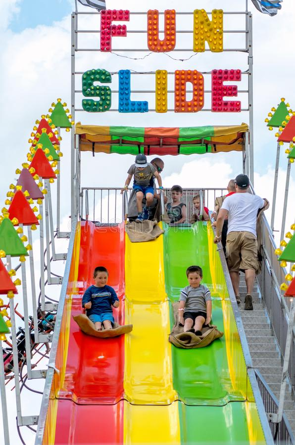 Free Racing Down A Fun Slide Royalty Free Stock Image - 155152016