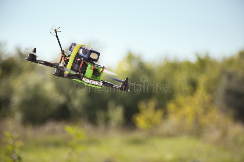 Racing drones chasing in the sky.  stock photos