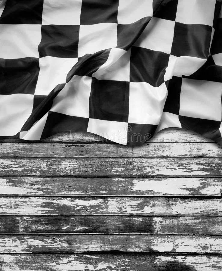 Racing flag on boards. Racing flag and wooden boards royalty free stock photo