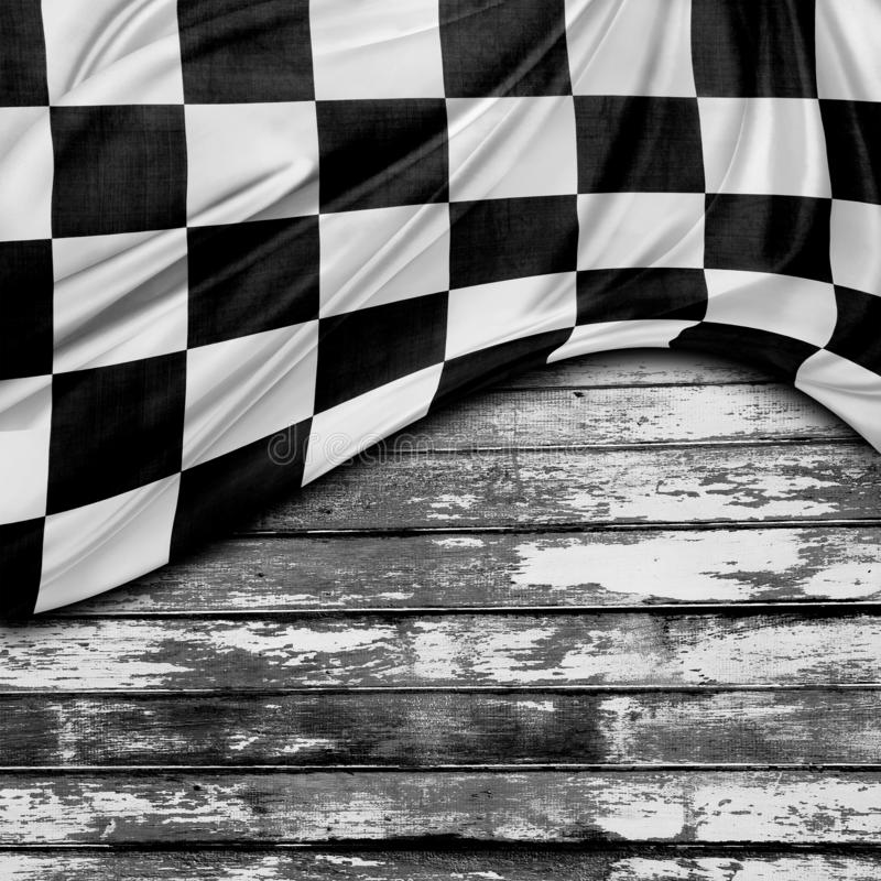 Racing flag on boards. Racing flag and wooden boards stock photo