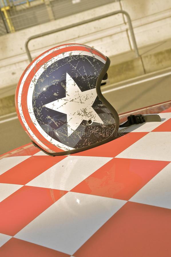 Racing Helmet on Car Roof royalty free stock photo