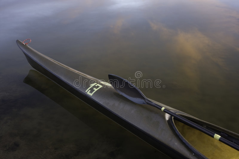 Download Racing Kayak, Wing Paddle, Calm Lake Stock Photo - Image of racing, boat: 7297022