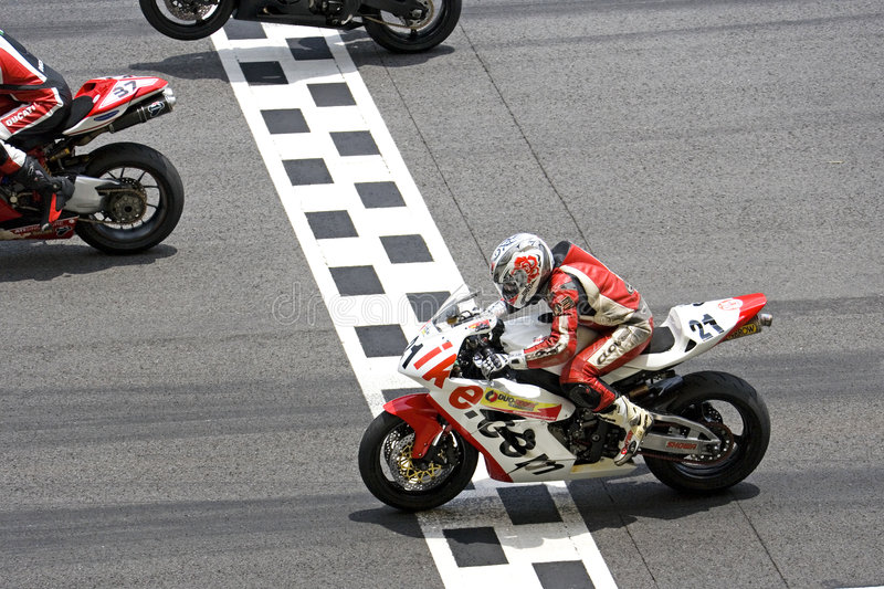 Racing motorbikes stock photography