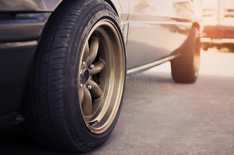 Racing rim wheels in retro car stock photography