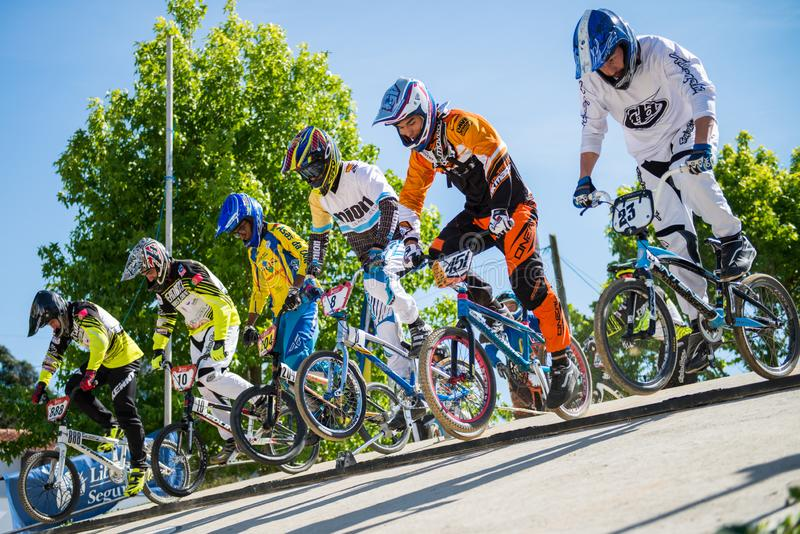 Racing start during trainings. ESTARREJA, PORTUGAL - MAY 16, 2015: Racing start during trainings on the Taca de Portugal Bmx stock photo