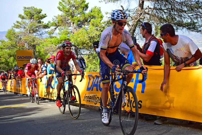 Racing Uphill In La Vuelta España Cycle Race. Riders struggling near the mountain top finish in the 2017 La Vuelta espana bike race royalty free stock image