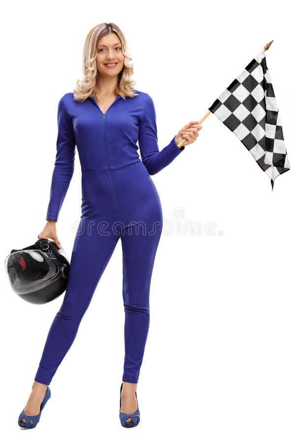 Racing woman holding a checkered race flag. Full length portrait of a racing woman holding a checkered race flag and a helmet isolated on white background royalty free stock photos