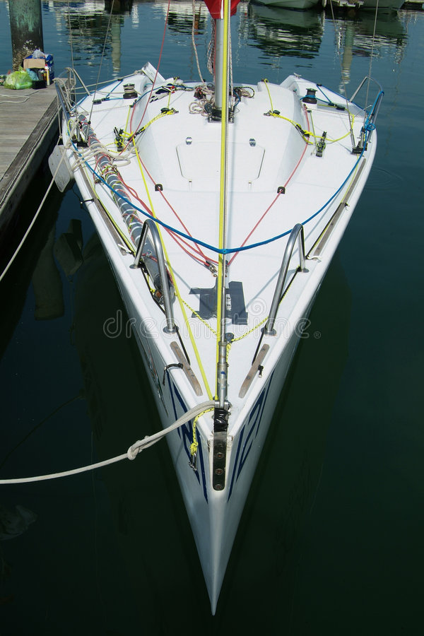 Racing yacht in the harbour royalty free stock photography