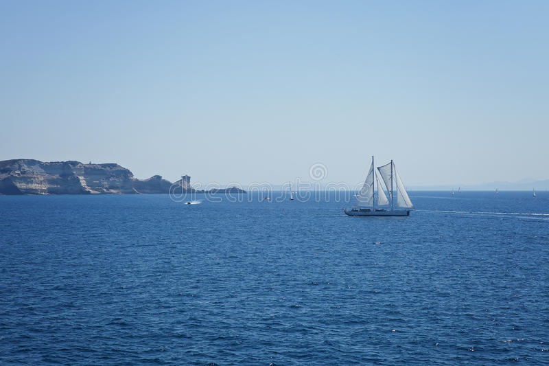 Racing yacht. In the Mediterranean Sea on blue sky background royalty free stock photography