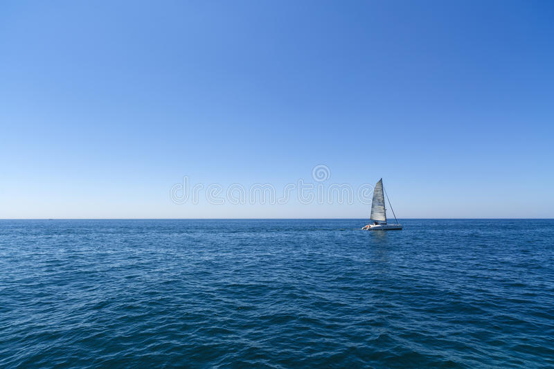 Racing yacht in the Mediterranean sea. On blue sky background stock images
