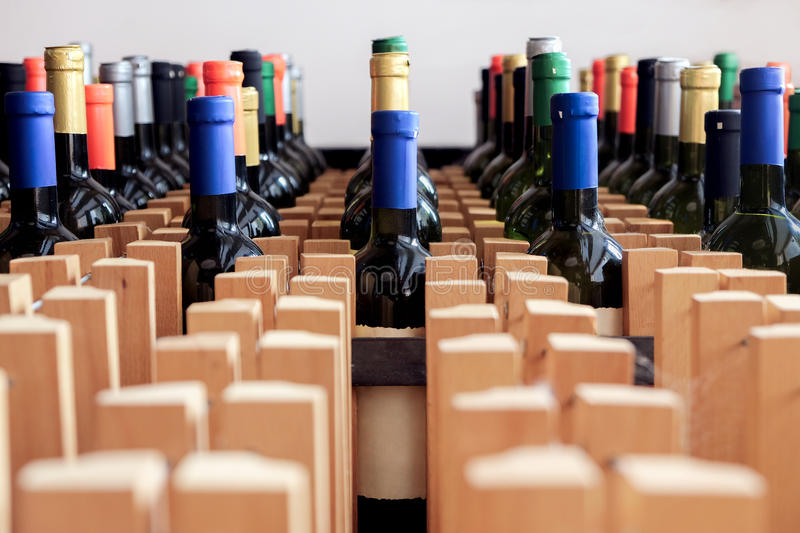 Rack of bottles of wine with blank label royalty free stock images