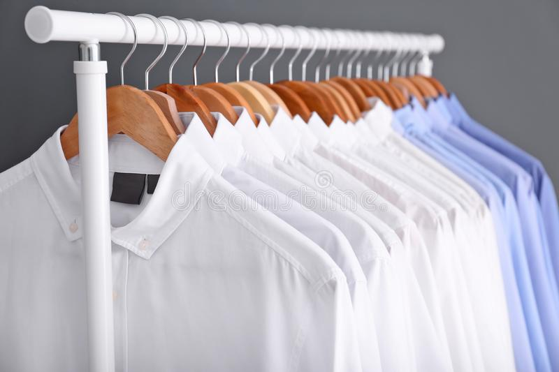 Rack with clean clothes on hangers. After dry-cleaning stock photo