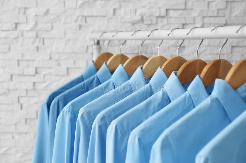 Rack with clean clothes on hangers after dry-cleaning. Indoors royalty free stock image