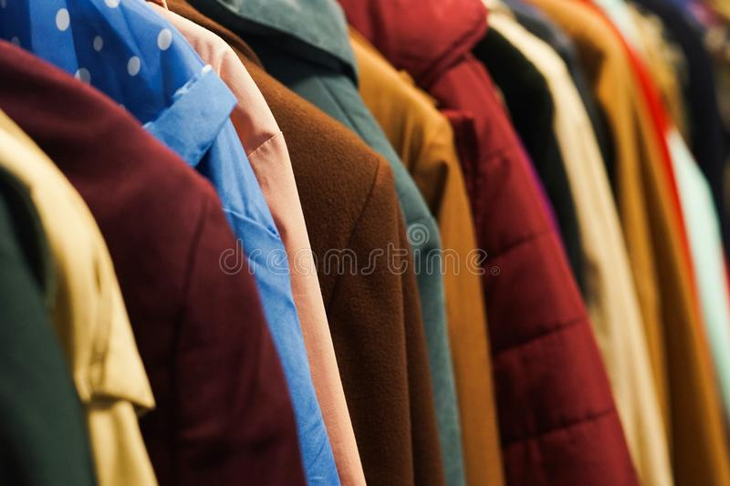 Colourful coats in the charity shop. royalty free stock image
