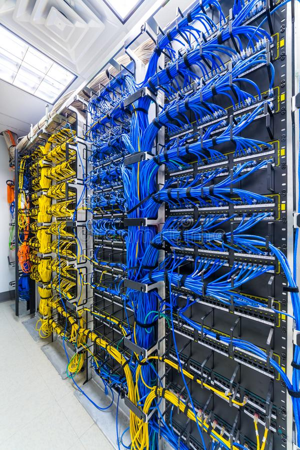 Rack with generic ethernet cables. Rack with generic ethernet cat5e cables, part of a large company data center stock photography