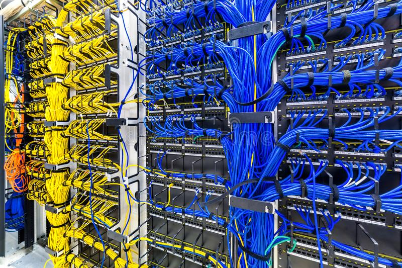 Rack with generic ethernet cat5e cables. Part of a large company data center royalty free stock photo