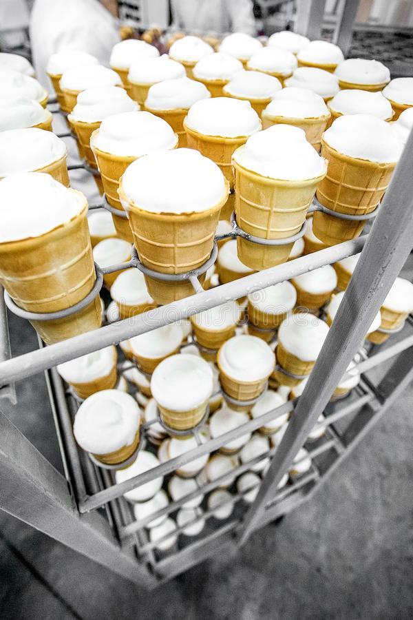 Rack with ice-cream ready for packing royalty free stock image