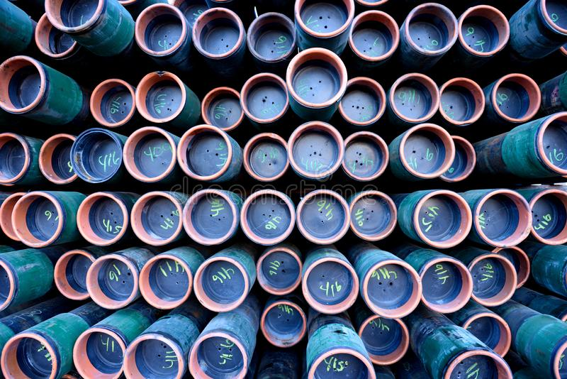 Rack of iron metal pipes used for oil & gas industry drilling stock images
