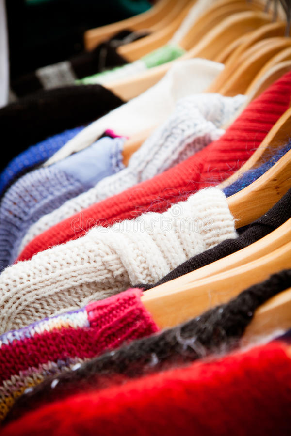 Rack of jumpers at market, close-up royalty free stock image