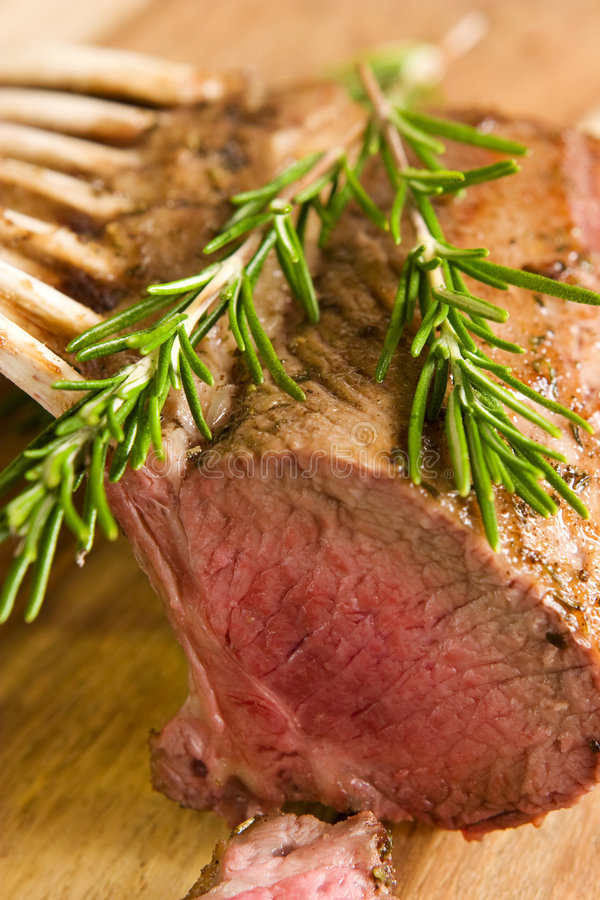 Rack of lamb. Close-up of roasted rack of lamb royalty free stock photos