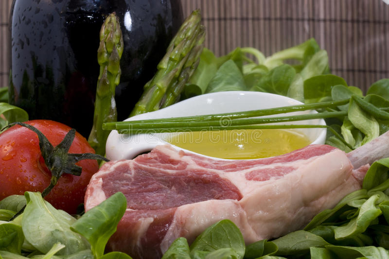 Rack of lamb and ingredients stock image