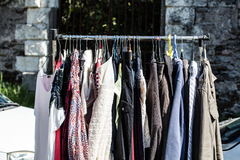 Download Rack Of Old Fashioned Womens Clothes At Garage Sale Stock Image