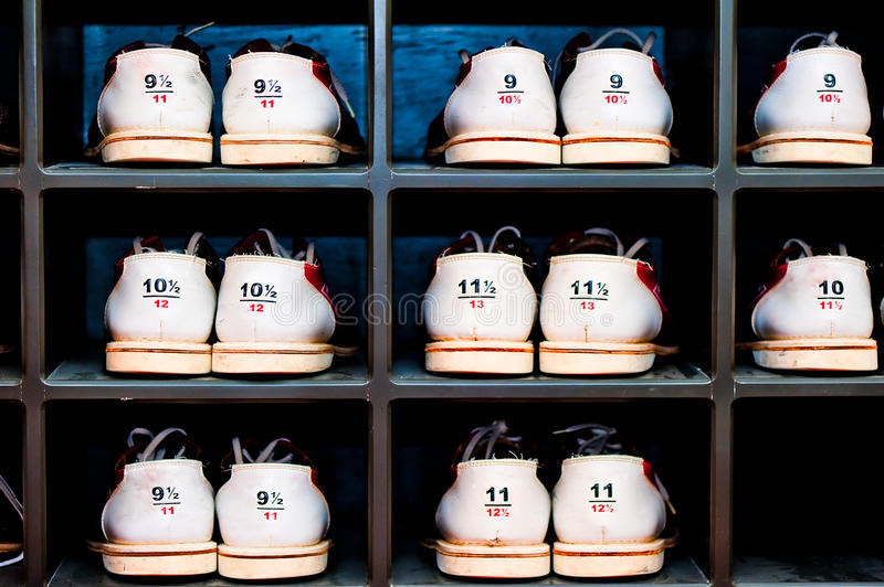 Rack with shoes for bowling different sizes stock photos