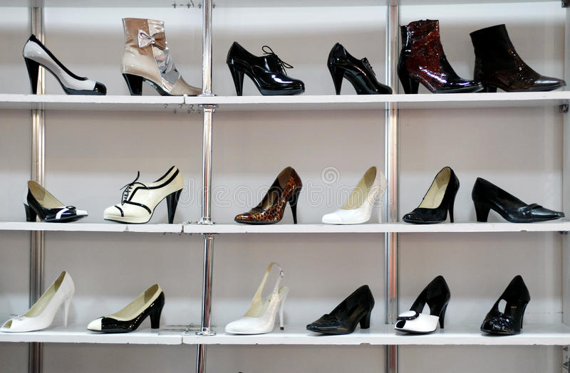 Rack of shoes in shop or department store stock photos