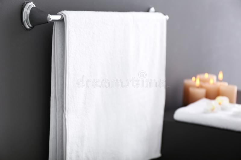 Rack with towel on grey wall royalty free stock photography