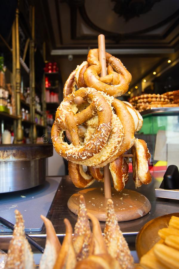 Traditional Bavarian style pretzels in window display. Rack of Traditional Bavarian style pretzels in retail window display royalty free stock images