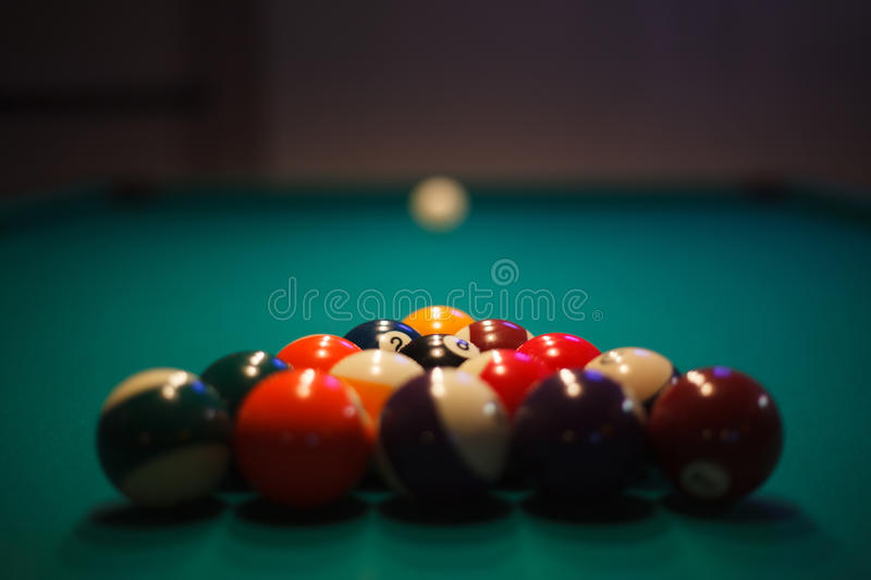 Racked and ready - Pool balls set up for play stock images