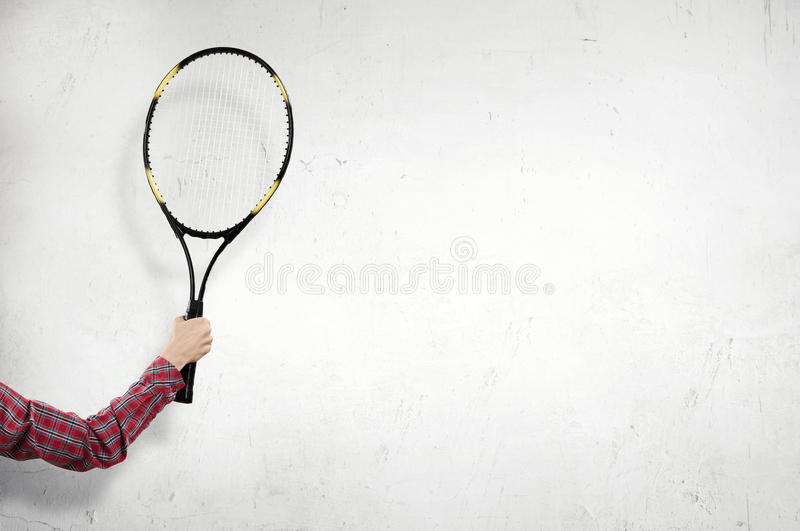 Racket in person hand . Mixed media. Close up on hand with big tennis racket stock photography