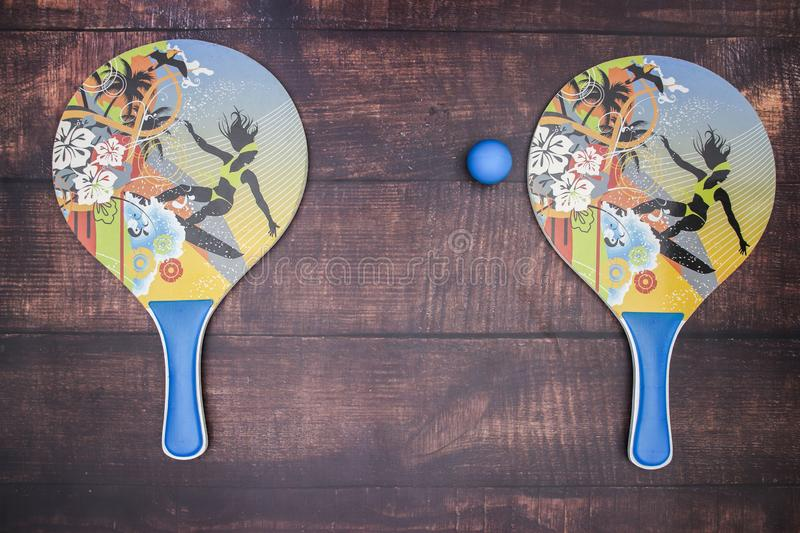 Rackets for table tennis and blue ball stock image